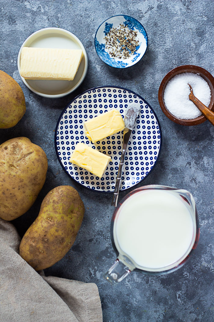 To make this recipe you need russet potatoes, butter, milk, heavy cream, white cheddar cheese, salt and pepper.
