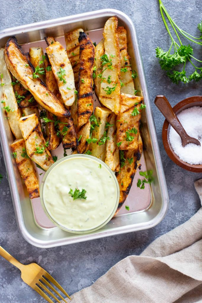 This is the best and easiest recipe for grilled potato wedges. Make your favorite side dish on the grill and enjoy it this summer!
