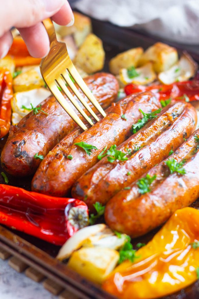 An easy sheet pan dinner, this Italian sausage potatoes peppers and onions is perfect for any day of the week. It's fuss-free and cleaning up is a breeze!