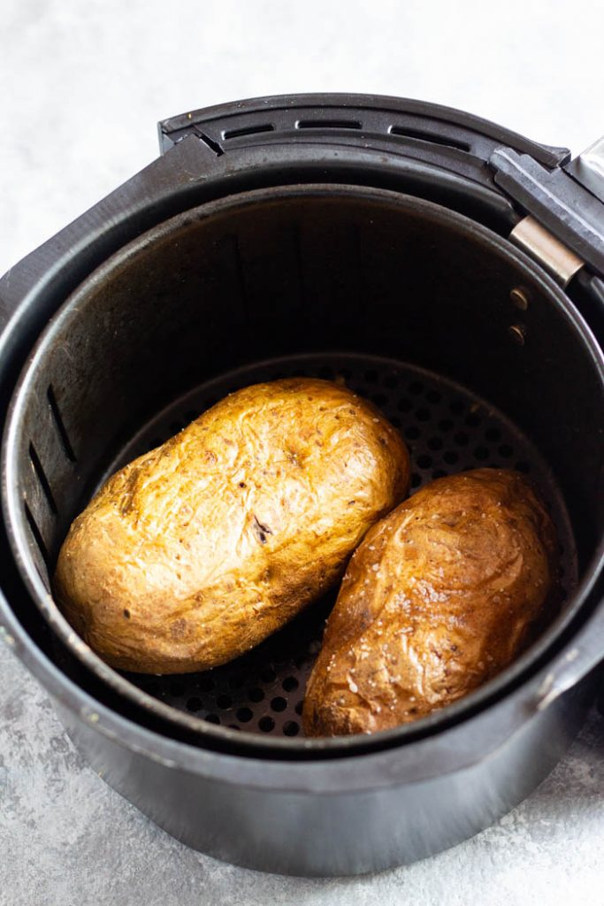 Cook the potatoes in the air fryer for 40 minutes and flip halfway so they get crispy.